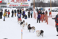 Abby Brooks and dog team leaves the start line of the 2013 Junior Iditarod on Knik Lake.  Knik Alaska..Photo by Jeff Schultz/IditarodPhotos.com   Reproduction prohibited without written permission