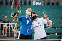 CARY, NC - SEPTEMBER 12: Kansas City players Hailie Mace and Kristen Hamilton pose for a photo while visiting after a game between Portland Thorns FC and North Carolina Courage at WakeMed Soccer Park on September 12, 2021 in Cary, North Carolina.