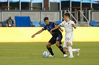 SAN JOSE, CA - SEPTEMBER 5: Chris Wondolowski #8 of the San Jose Earthquakes is defended by Cole Bassett #26 of the Colorado Rapids during a game between Colorado Rapids and San Jose Earthquakes at Earthquakes Stadium on September 5, 2020 in San Jose, California.
