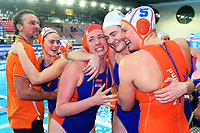 Arno Havenga Team Netherlands Head coach and some players celebrate the victory of the semi final and the qualification for Tokyo 2020 Olympic games <br /> Netherlands NED Vs Greece GRE <br /> Semifinal 1st-4th place  <br /> Trieste (Italy) 23/01/2021 Bruno Bianchi Aquatic Center <br /> Fina Women's Water Polo Olympic Games Qualification Tournament 2021 <br /> Photo Andrea Staccioli / Deepbluemedia / Insidefoto