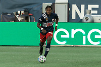FOXBOROUGH, MA - SEPTEMBER 23: DeJuan Jones #24 of New England Revolution brings the ball forward during a game between Montreal Impact and New England Revolution at Gillette Stadium on September 23, 2020 in Foxborough, Massachusetts.
