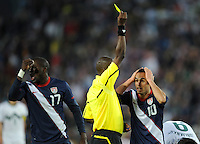Landon Donovan of USA and Jozy Altidore of USA show their disbelief  that Marko Suler of Slovenia only receives a yellow card from referee Koman Coulibaly
