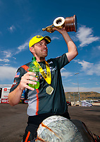 Jul 21, 2019; Morrison, CO, USA; NHRA pro stock motorcycle rider Andrew Hines celebrates after winning the Mile High Nationals at Bandimere Speedway. Mandatory Credit: Mark J. Rebilas-USA TODAY Sports