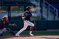 Atlanta Braves Johan Camargo (17) bats during a Major League Spring Training game against the Boston Red Sox on March 7, 2021 at CoolToday Park in North Port, Florida.  (Mike Janes/Four Seam Images)