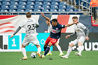 FOXBOROUGH, MA - APRIL 17: Damian Rivera #72 of New England Revolution II passes the ball under pressure from Victor Falck #23 of Richmond Kickers during a game between Richmond Kickers and Revolution II at Gillette Stadium on April 17, 2021 in Foxborough, Massachusetts.