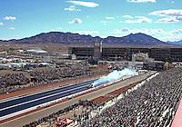 Nov 2, 2014; Las Vegas, NV, USA; Overall view of The Strip at Las Vegas Motor Speedway as NHRA funny car driver Alexis DeJoria does a burnout. Mandatory Credit: Mark J. Rebilas-USA TODAY Sports