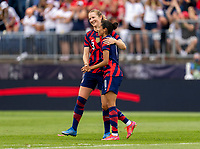 EAST HARTFORD, CT - JULY 5: Samantha Mewis #3 hugs Christen Press #11 of the USWNT during a game between Mexico and USWNT at Rentschler Field on July 5, 2021 in East Hartford, Connecticut.