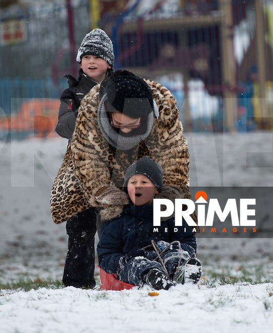 Mum gives her son a push while sledging in the park in Sidcup following Heavy Snowfall at Sidcup, Kent, England on the 8 February 2021. Photo by Alan Stanford.