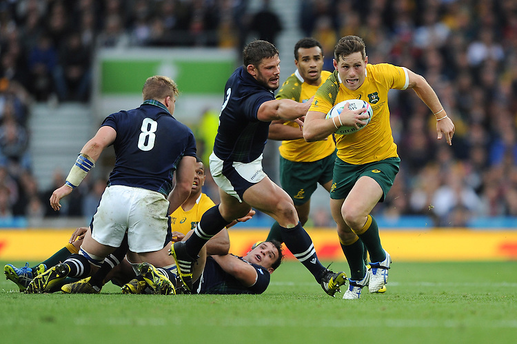 Bernard Foley of Australia accelerates away from Ross Ford of Scotland during the Quarter Final of the Rugby World Cup 2015 between Australia and Scotland - 18/10/2015 - Twickenham Stadium, London<br /> Mandatory Credit: Rob Munro/Stewart Communications