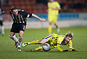 KILMARNOCK'S JAMES DAYTON IS BROUGHT DOWN BY PARS MARK KERR