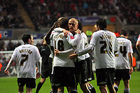 ATTENTION SPORTS PICTURE DESK<br /> Pictured: Gorka Pintado (C) of Swansea City is mobbed by team mates <br /> Re: Coca Cola Championship, Swansea City Football Club v Leicester City at the Liberty Stadium, Swansea, south Wales. Saturday 16 January 2010
