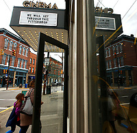 'We Will Get Through This Pittsburgh' sign is posted outside of the Row House Cinemas in the Lawrenceville neighborhood on Monday March 16, 2020 in Pittsburgh, Pennsylvania. (Photo by Jared Wickerham/Pittsburgh City Paper)