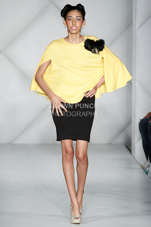Model walks runway in  shoes from the Pinky Sez 2014 collection by Tyyan Williams, during Fashion Week Brooklyn Fall Winter 2014, at Industry City, on March 15, 2014.