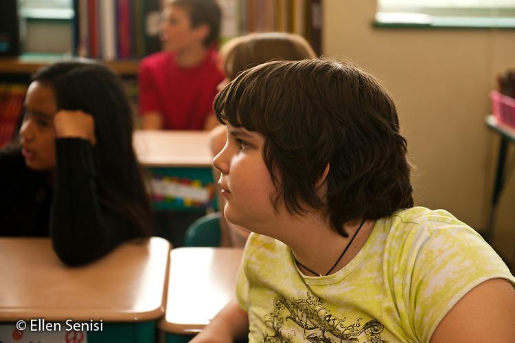 MR / Little Falls, NY. Benton Hall Academy (public elementary school). Grade 5. Student (girl: 10) listening in class. MR: Dis1. ID: AK-g5s. © Ellen B. Senisi.