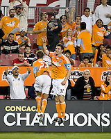 Houston Dynamo midfielder Stuart Holden (22) and Houston Dynamo defender Bobby Boswell (32) celebrate a goal.  Houston Dynamo tied Atlante FC 1-1 at Robertson Stadium in Houston, TX on February 24, 2009 in CONCACAF Champions League play .  Photo by Wendy Larsen/isiphotos.com
