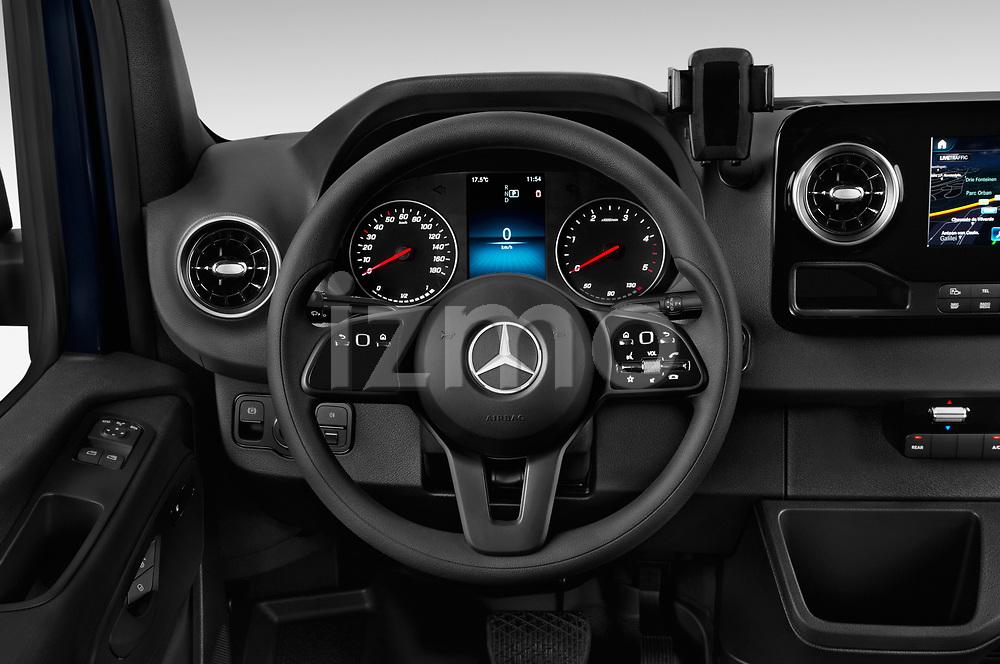 Car pictures of steering wheel view of a 2019 Mercedes Benz Sprinter-Tourer Design-Line 4 Door Passanger Van Steering Wheel