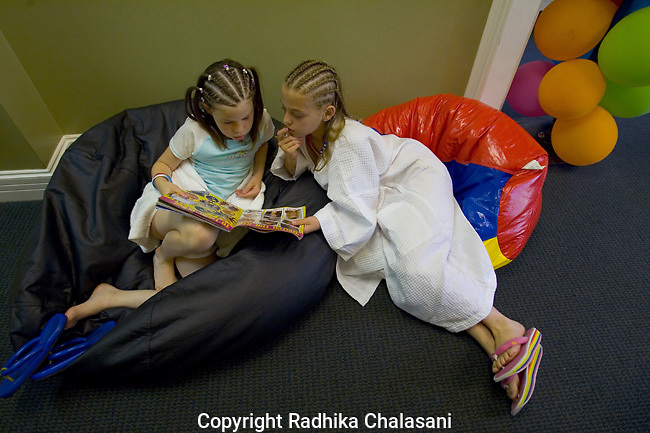 SAN ANTONIO, TEXAS-MARCH 25: Sydney (L), 7, and her cousin Madison (10) wait for massages and facials at the kids-only spa, Spaaht, at the Hyatt Regency Hill Country Resort, Spaaht, March 25, 2005 in San Antonio.The spa is one of a growing number across the U.S. catering to the teen and pre-teen age group offering massages (40 USD), facials (40 USD), glitter manicures (30 USD) and pedicures (35 USD) and hair braiding (3.50 USD/braid). ©Radhika Chalasani