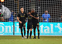 LAKE BUENA VISTA, FL - JULY 18: Diego Rossi #9 of LAFC celebrate his penalty shot goal with teammates Bradley Wright-Phillips #66 and Eduard Atuesta #20 during a game between Los Angeles Galaxy and Los Angeles FC at ESPN Wide World of Sports on July 18, 2020 in Lake Buena Vista, Florida.
