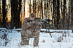 Crossbow hunter taking aim