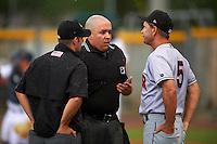 Jupiter Hammerheads manager Randy Ready (5) talks with umpires J.C. Velez (center) and Ben Sontaga during a game against the Lakeland Flying Tigers on April 14, 2016 at Henley Field in Lakeland, Florida.  Lakeland defeated Jupiter 5-0.  (Mike Janes/Four Seam Images)