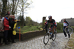 Fabian Cancellara (SUI) Radioshack Nissan has to change bikes at the bottom of the Molenberg climb during the 96th edition of The Tour of Flanders 2012, running 256.9km from Bruges to Oudenaarde, Belgium. 1st April 2012. <br /> (Photo by Steven Franzoni/NEWSFILE).