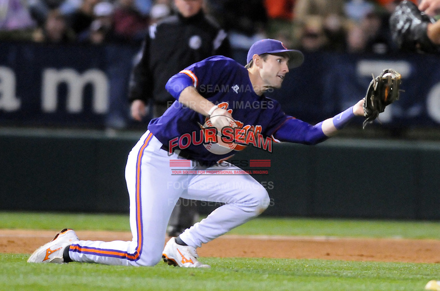 Third baseman John Hinson (4) of the Clemson Tigers twists to catch a pop up hit by Jackie Bradley Jr. in the sixth inning inning of a game against the South Carolina Gamecocks on Tuesday, March 8, 2011, at Fluor Field in Greenville, S.C.  Photo by Tom Priddy / Four Seam Images