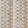 Flatweave Medio, a hand-cut stone mosaic, shown in tumbled Allure, Driftwood, Argent Blue, Bianco Antico, Lagos Gold, Renaissance Bronze, Azure, and Travertine White, is part of the Tissé® collection for New Ravenna.