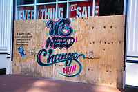 Graffiti Calling for Political and Social Change Now, Washington DC, USA, October 2020. Covid-19 Restrictions have resulted in the closing of the store.