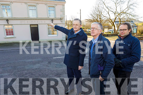 John Hartnett pointing to the pub belonging to Paddy Kennedy who was one of victims the troubles in Aunascal and was executed on the 28th of August 1920. Standing with Michael Kennedy and Lawrence Jones