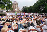 Hundreds of peace activists stage a die-in in front of the A-Bomb Dome in Peace Memorial Park, Sunday, Aug. 6, 1995.  At the same moment 50 years ago the atomic bomb was dropped over Hiroshima. (AP Photo/Paul Sakuma)
