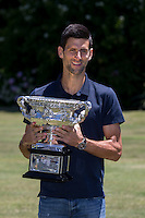 February 1, 2016: Novak Djokovic of Serbia poses with the Australian Open trophy the Norman Brookes Challenge Cup during the Men's Champion Photocall  at Government House, Melbourne, Australia. Photo Sydney Low