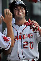 Second baseman Chad De La Guerra (20) of the Greenville Drive is congratulated after scoring a run in a game against the Augusta GreenJackets on Thursday, June 9, 2016, at Fluor Field at the West End in Greenville, South Carolina. Augusta won, 8-2. (Tom Priddy/Four Seam Images)