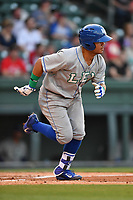Second baseman Gabriel Cancel (12) of the Lexington Legends runs toward first in a game against the Greenville Drive on Wednesday, April 12, 2017, at Fluor Field at the West End in Greenville, South Carolina. Greenville won, 4-1. (Tom Priddy/Four Seam Images)