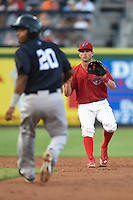 Clearwater Threshers shortstop Devin Lohman (8) waits for a throw as Ericson Leonora (20) is caught in a run down during a game against the Tampa Yankees on April 21, 2015 at Bright House Field in Clearwater, Florida.  Leonora was tagged out by Lohman as Clearwater defeated Tampa 3-0.  (Mike Janes/Four Seam Images)