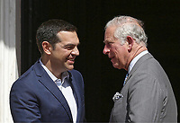 Prince Charles is greeted by Prime Minister Alexis Tsipras on the steps of the Megaro Maximou (Maximos Mansion)