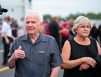 Aug 31, 2019; Clermont, IN, USA; NHRA former pro stock driver Warren Johnson (left) with wife Arlene Johnson during qualifying for the US Nationals at Lucas Oil Raceway. Mandatory Credit: Mark J. Rebilas-USA TODAY Sports