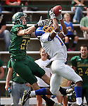 SPEARFISH SD -- OCTOBER 4 -- Brenton Hunter #16 (right) of Dakota State University grabs an interception in front of Corey Wheeler #20 of Black Hills State during their opening drive Saturday at Lyle Hare Stadium in Spearfish, S.D. (Photo by Dick Carlson/Inertia)