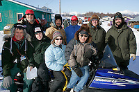 """Monday March 12, 2007   ----   Local and """"imported"""" volunteers at Kaltag stop for a group photo.   Pictured are checkers, vets, communications people and helpers."""