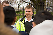 Safer Schools Police Officer Duncan Evans, part of the Extended School Team at George Green Secondary School, Isle of Dogs, Tower Hamlets, talks to students outside the school gates.
