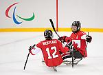 Greg Westlake and Adam Dixon, Sochi 2014 - Para Ice Hockey // Para-hockey sur glace.<br /> Team Canada takes on Sweden in Para Ice Hockey // Équipe Canada affronte la Suède en para-hockey sur glace. 08/03/2014.