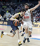Real Madrid's Sergio Llull (r) and Fenerbahce Istambul's Nikola Kalinic during Euroleague Quarter-Finals 3rd match. April 19,2016. (ALTERPHOTOS/Acero)