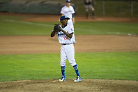 Ogden Raptors relief pitcher Luis Pasen (22) gets ready to deliver a pitch during a Pioneer League game against the Great Falls Voyagers at Lindquist Field on August 23, 2018 in Ogden, Utah. The Ogden Raptors defeated the Great Falls Voyagers by a score of 8-7. (Zachary Lucy/Four Seam Images)