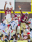 Florida State defensive tackle Demarcus Christmas, center, blocks a field goal attempt by Delaware State kicker Wisdom Nzidee in the first half of an NCAA football game in Tallahassee, Fl.  Florida State defeated Delaware State 77-6.  Also pictured are defensive ends Brian Burns (99) and Josh Sweat (9).