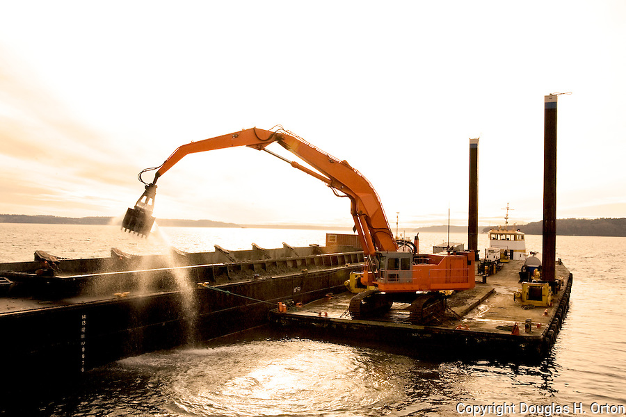 Dredging the channel.  Des Moines, WA on Puget Sound.  Channel dredged of silt from Des Moines Creek.