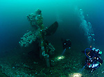 A scenic part of the wreck, divers check out the colourful propellor and rudder post in great visibility.