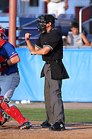 Home plate umpire Clayton Hamm makes a call during a game between the Batavia Muckdogs and Auburn Doubledays at Dwyer Stadium on June 20, 2012 in Batavia, New York.  Batavia defeated Auburn 9-3.  (Mike Janes/Four Seam Images)
