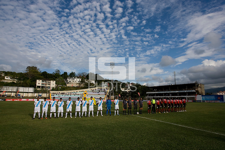 The teams line up for the national anthems during the group stage of the CONCACAF Men's Under 17 Championship at Jarrett Park in Montego Bay, Jamaica. Trinidad & Tobago defeated Guatemala, 1-0.