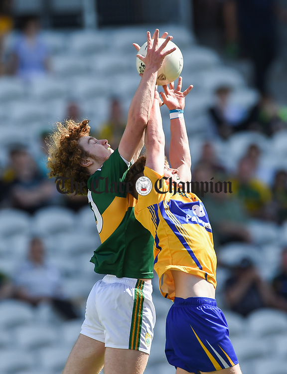 Paul Walsh of Kerry in action against Darragh Connelly of Clare during their Munster Minor football final at Pairc Ui Chaoimh. Photograph by John Kelly.