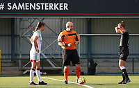 Match referee Willem Huyghe is about to toss the coin before a female soccer game between Oud Heverlee Leuven and Eendracht Aalst Ladies  on the third matchday of the 2020 - 2021 season of Belgian Womens Super League , Sunday 4 th of October 2020  in Heverlee , Belgium . PHOTO SPORTPIX.BE | SPP | SEVIL OKTEM