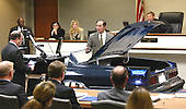 Wynn Gregory Warren, a United States Federal Bureau of Investigation (FBI) visual information specialist, center, gestures as he testifies in front of a model of a trunk of the Chevrolet Caprice that sniper suspect John Allen Muhammad was captured in during court proceedings in Virginia Beach Circuit Court in Virginia Beach, Virginia, November 6, 2003.  Judge Leroy Millette, Jr., right, and defense attorney Peter Greenspun, left, listen. <br /> Credit: Tracy Woodward - Pool via CNP